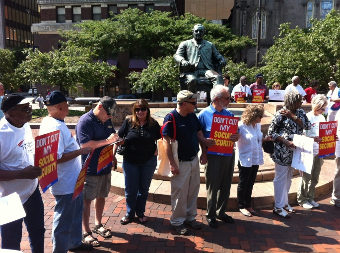 rally at the Tom Johnson statue.