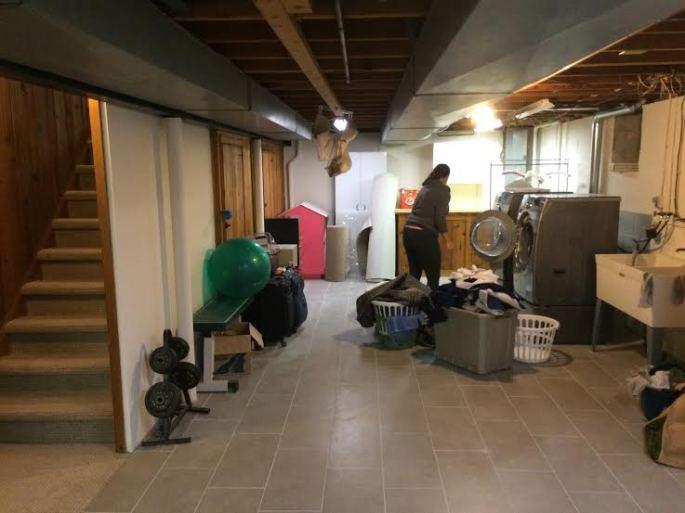 Valerie doing laundry in utility room