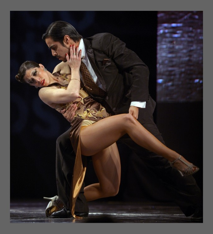 The Argentine couple of Barbara Ferreyra (L) and Nahuel Tortosa dance during the semifinal round of the Stage Tango competition at the Tango Dance World Championship in Buenos Aires on August 25, 2012.   AFP PHOTO / Alejandro PAGNI        (Photo credit should read ALEJANDRO PAGNI/AFP/GettyImages)